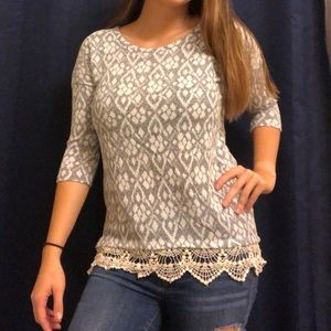 Knit top with crocheted bottom detail